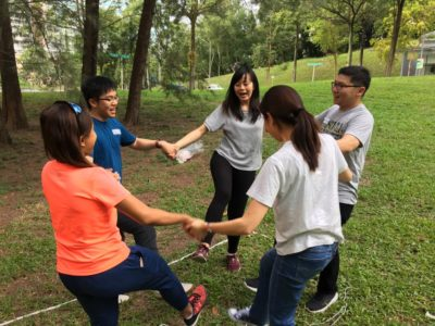 Team building outdoors holding hands